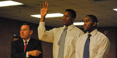 Ike Azotam raises his hand, identifying himself to Judge Philip Scarpallino, flanked by lawyer Thomas Lynch (left) and James Johnson. Photo by Anna Brundage/Chronicle