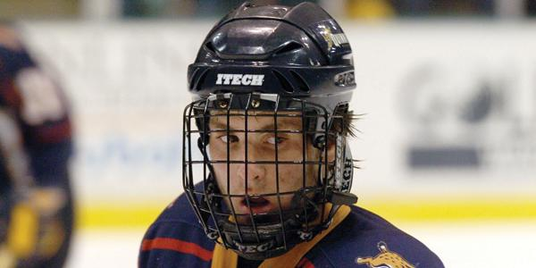 Former men's hockey great returns as assistant coach