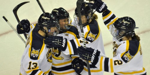 The Bobcats celebrate after Erica Uden Johansson's first-period goal.
