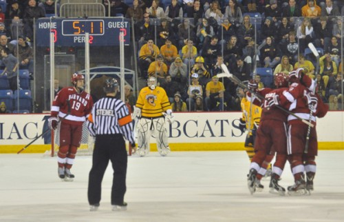 Harvard 6, Quinnipiac 3Quinnipiac goalie Eric Hartzell looks on as Harvard players celebrate Danny Biega's game-tying goal in the second period in Friday's game.