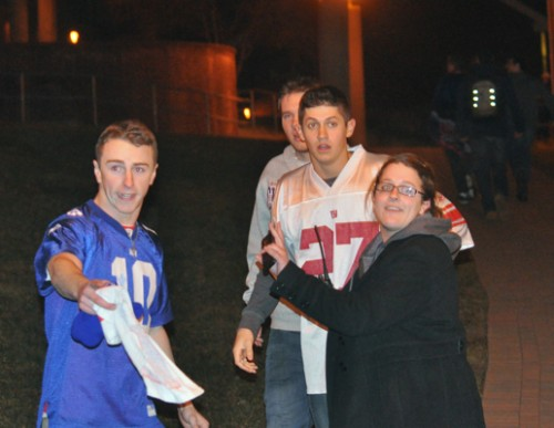 Students riot following Super Bowl XLVIA residential assistant talks to students on campus after Super Bowl XLVI