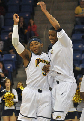<h3>Quinnipiac 73, Robert Morris 69</h3>Quinnipiac's James Johnson and Nate Gause celebrate after Johnson hits a 3-pointer in the second half of Saturday's game.