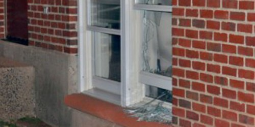 A student was arrested after breaking a window in Village during Sunday night's Super Bowl celebration.