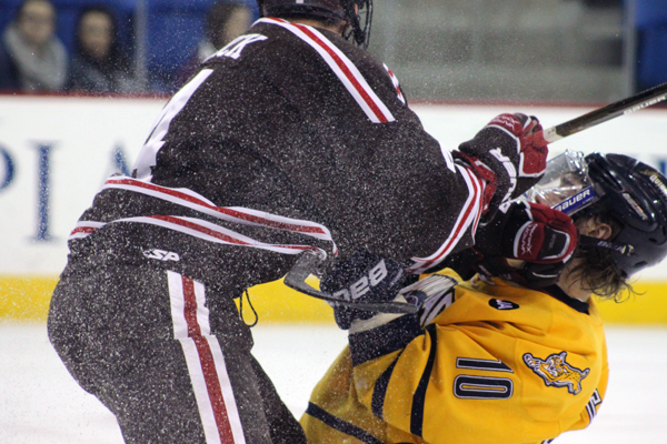 <h3>Quinnipiac beats Brown, 4-2</h3>Quinnipiac's Connor Jones gets checked by Brown's Kyle Quick in the first period.