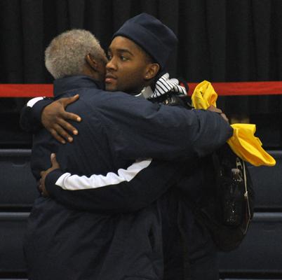 LIU-Brooklyn 78, Quinnipiac 75Quinnipiac's James Johnson hugs his father after Sunday's game vs. LIU-Brooklyn.