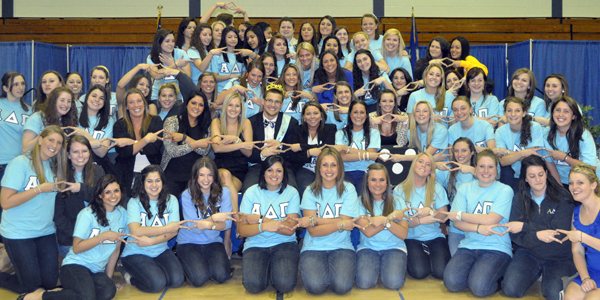 <h3>King Of Diamonds</h3>Sisters of Alpha Delta Pi show their diamonds with the newly crowned King of Diamonds Tom Booth, Monday night in Burt Kahn.