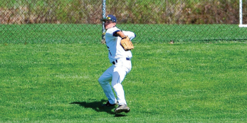 """Former Quinnipiac right fielder Ryan Ullrich plays a ball in the outfield on the hill, """"Rizzo's Ridge."""" Head coach Dan Gooley named the hill in 2004 after former player Ryan Rizzo because of his ability to play the right field so well."""