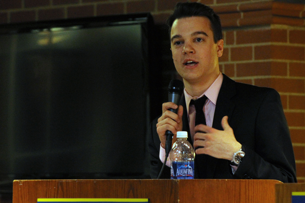 Ryan Scanlon speaks to students who came to the Student Government Association debate for its annual elections.