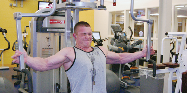 Tyler Smith pushes 245 pounds using his pectoral muscles. His workouts are only half the battle to achieving his goal of becoming a professional bodybuilder. The other half lies in his diet.