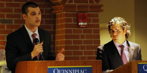 Theo Siggelakis (left) debates Evan Milas in front of students who came to the Student Government Association debate for its annual elections.