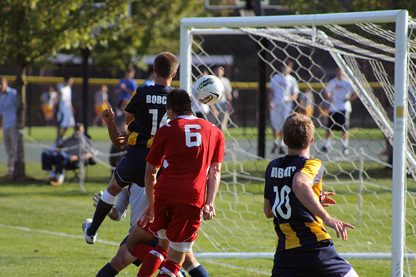 Players watch the pall during a shot on goal during Friday's game.