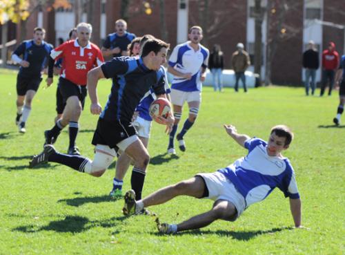 New Blue 43, CCSU 19New Blue's Marc Villalongue evades a defender to score a try in Saturday's game vs. CCSU.