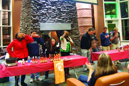 Students compete in a hot sauce contest after Kevin Robert's lecture on alternatives to unhealthy snacks.