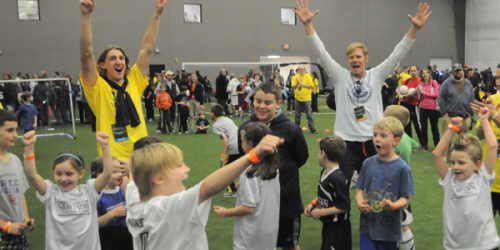 Stevenson Hawkey, Alexi Lalas and children play a game of soccer at Soccer Night in Newtown on Jan. 7.