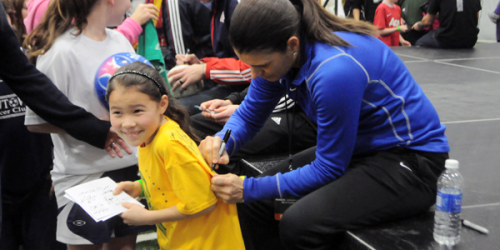 Mia Hamm signs a girl's shirt at Monday's Soccer Night in Newtown.
