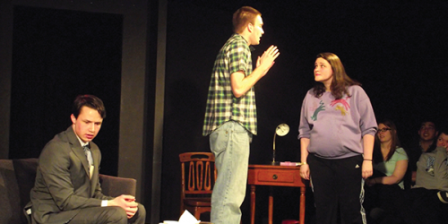 From left to right: Jacob Nadeau (Gabriel), Joe Skaleski (Michael), and Nicki Palmer (Mia) argue about the various possible fathers of her unborn child.