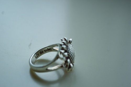 Brianne+wears+this+sunflower+ring+that+has+%22LIV+for+today%22+engraved+on+it.+