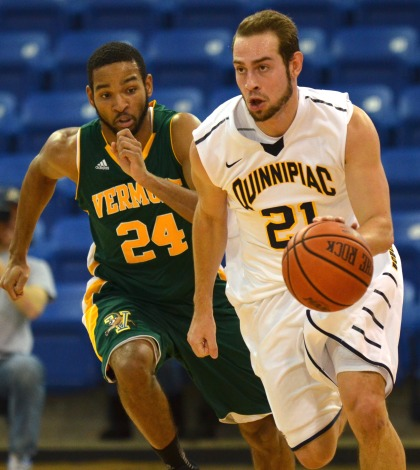 Men's basketball topples Vermont