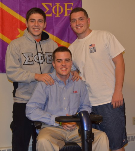 Sigma Phi Epsilon members carry Mullaney up Sleeping Giant