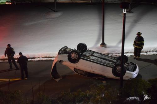 Car flips over on York Hill