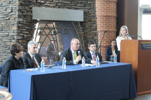 From left to right: Vice President and Dean of Students Monique Drucker, Vice President for Facilities and Capital Planning Salvatore Filardi, Executive Vice President and Provost Mark Thompson, Student Body President Jonathan Atkin, and Student Body Vice President Carly Hviding speak in front of students at the State of the QUnion.