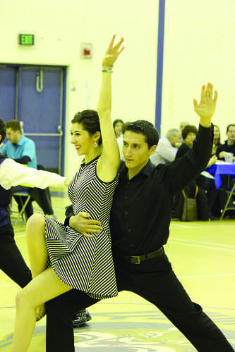 Senior+Stephanie+Azzarello+and+graduate+student+Alex+Diaz+dance+during+the+annual+Dancing+with+the+QU+Stars+event.
