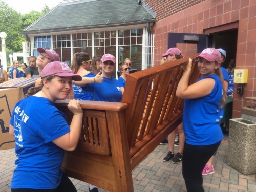Students volunteer to help freshmen move into their residence halls during Welcome Weekend.