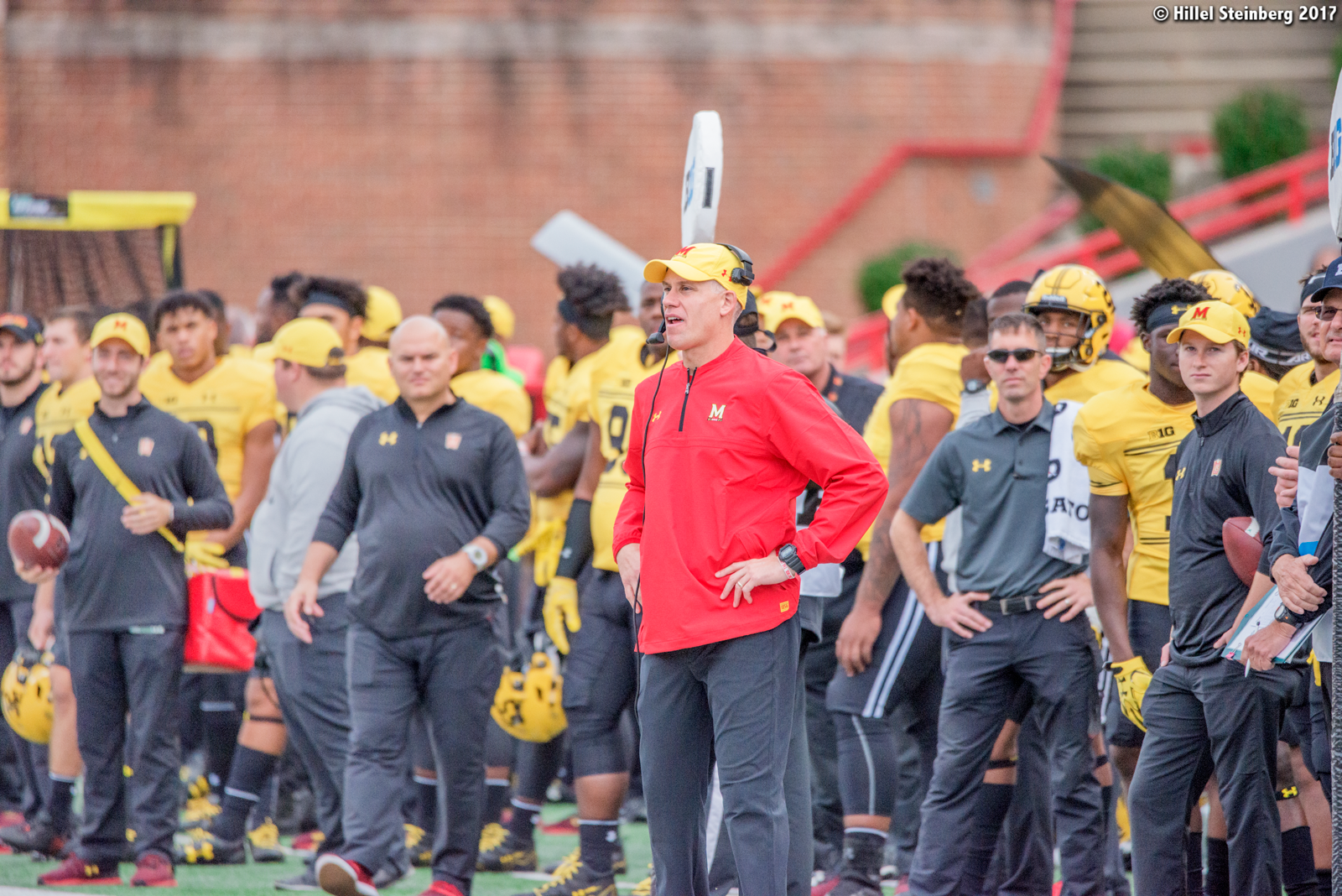 DJ Durkin (center) was fired from Maryland after almost three seasons as head coach.