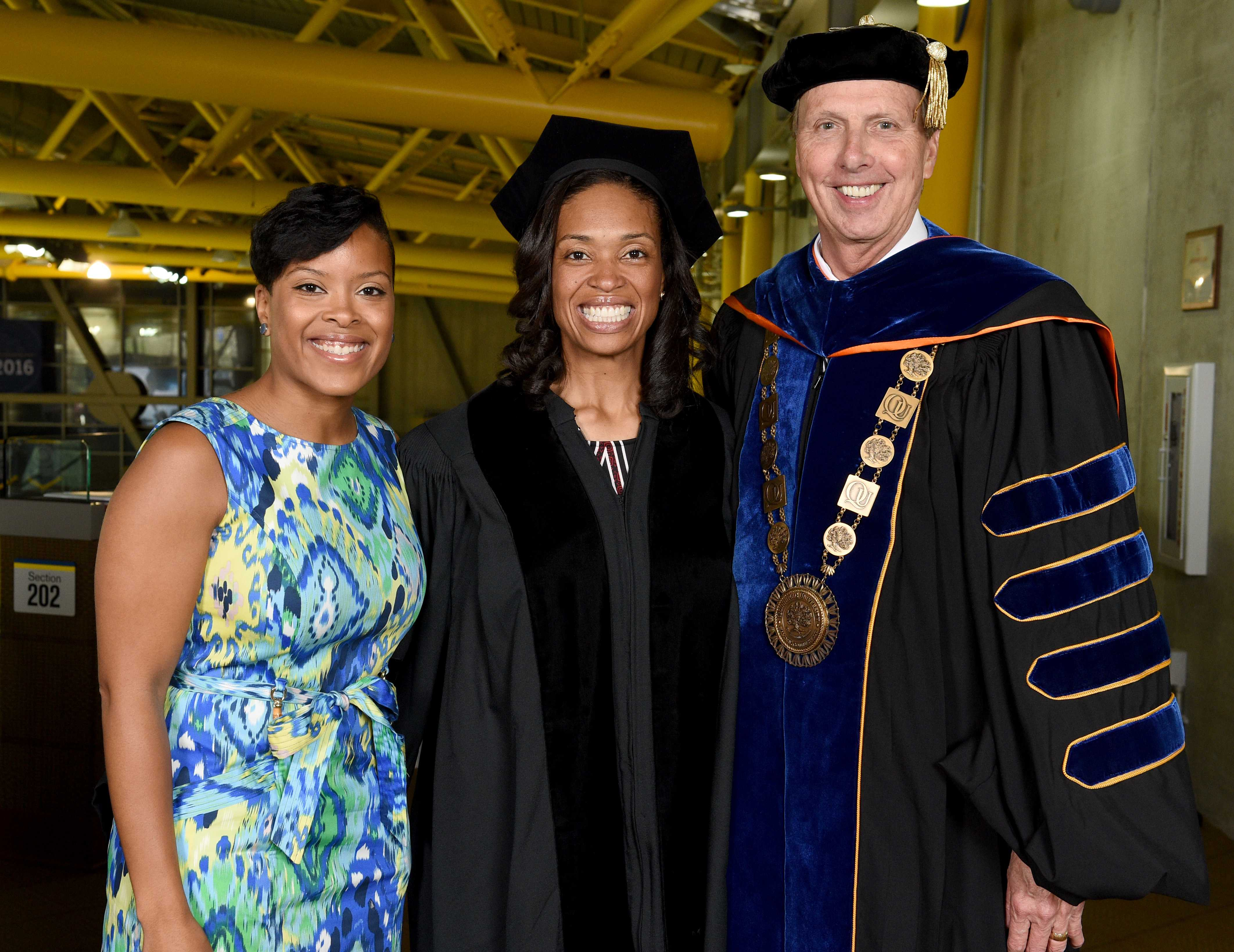 Sharrona Williams (center) and President John L. Lahey prior to the Quinnipiac University College of Arts and Sciences undergraduate commencement ceremonies Saturday, May 21, 2016, at TD Bank Sports Center.