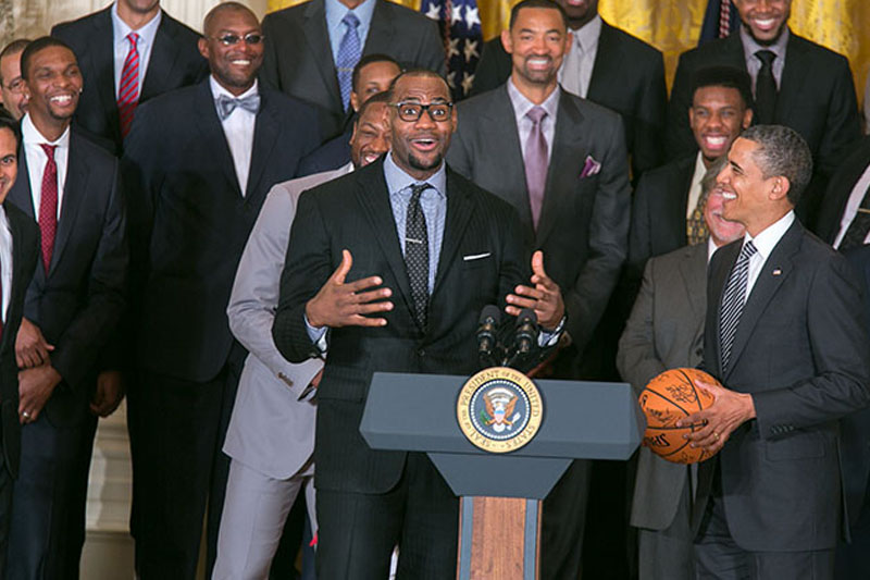 President Barack Obama accepts a basketball from LeBron James during a ceremony to welcome the Miami Heat to honor the team and their 2012 NBA Championship victory, in the East Room of the White House Jan. 28, 2013.