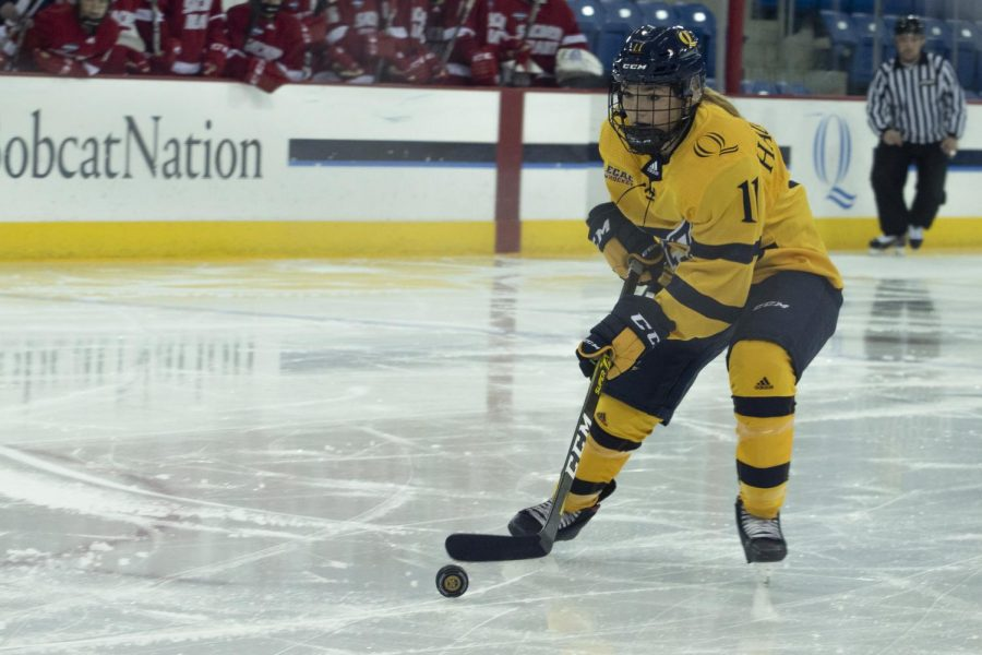 Kenzie Hauswirth carries the puck in the offensive zone.