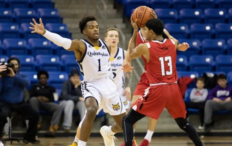 Former Quinnipiac guard Cam Young defends a Hartford ball handler.