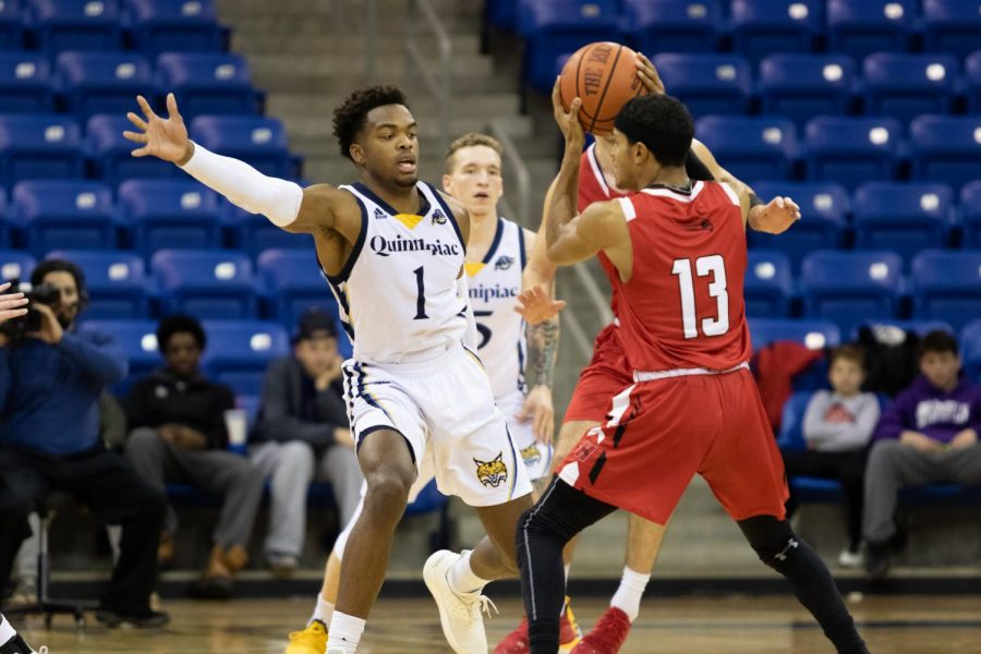 Former Quinnipiac guard Cam Young defends a Hartford ball handler.