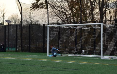 Junior goalkeeper Jared Mazzola watches as a penalty shot sails into the net.