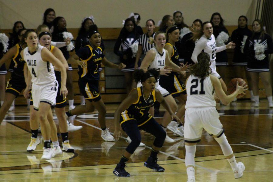 Redshirt junior guard Shaq Edwards defends Yale senior guard Roxy Barahman