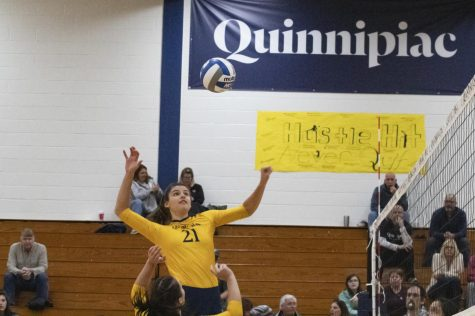 Junior middle blocker Gabby Horman rises up for a kill.
