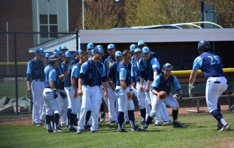 The Bobcats celebrate by handing off a football to every player who crosses home plate.
