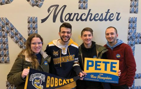 Jensen Wilson, Haktan Ceylan, Matthew Hawryluk and George Tzimorangas (left to right) at Pete Buttigieg's Manchester campaign headquarters.