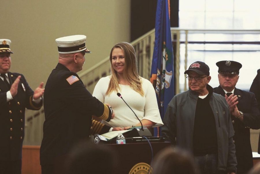 Courtney Vander May was presented with a certificate at a ceremony on Feb 10.