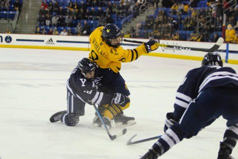 Senior forward Alex Whelan fires a shot on net.