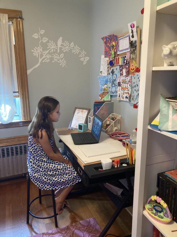 Hallie Sisco, age 9, works from home. The pandemic has blurred the lines between Professor Fussell Sisco's home and work life.