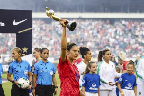 United States Women's National Team forward Carli Lloyd hoists the 2019 Women's World Cup trophy.