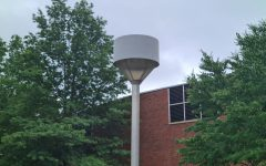 The Hamden Zoning Board of Appeals postponed the public hearing for Quinnipiac University's variance to install eight 50-foot light poles to September.