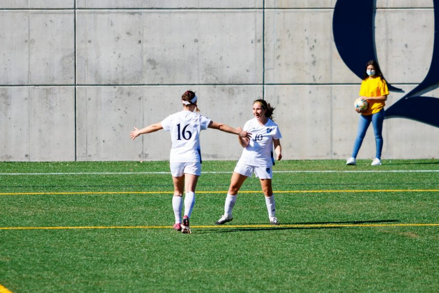 Senior midfielder Selena Salas (right) celebrates with junior defender Fleur Cordier (left) after scoring a goal on April 6, 2021.