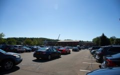Students wait in long lines to find available parking spots in the North Lot.