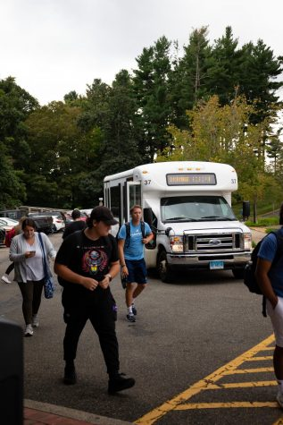 Students walk out of a shuttle that runs between Mount Carmel and York Hill campuses.