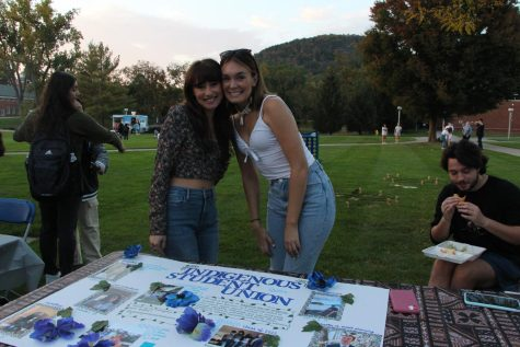 Rania Bensadok (left) and Kiara Tantaquidgeon (right), secretary and president of the Indigenous Student Union, spread the word about the organization at the Multicultural Student Leadership Councils Culture Fair on Oct. 15.