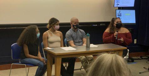 Three students read pieces regarding their cultures and identities alongside Quinnipiac professor J.T. Torres.